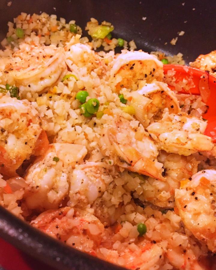 shrimp cauliflower fried rice in a pan