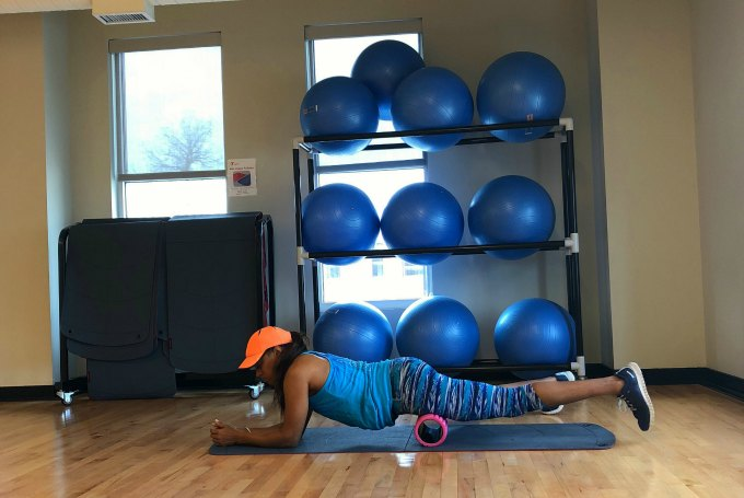 girl foam rolling quads and lower body muscles