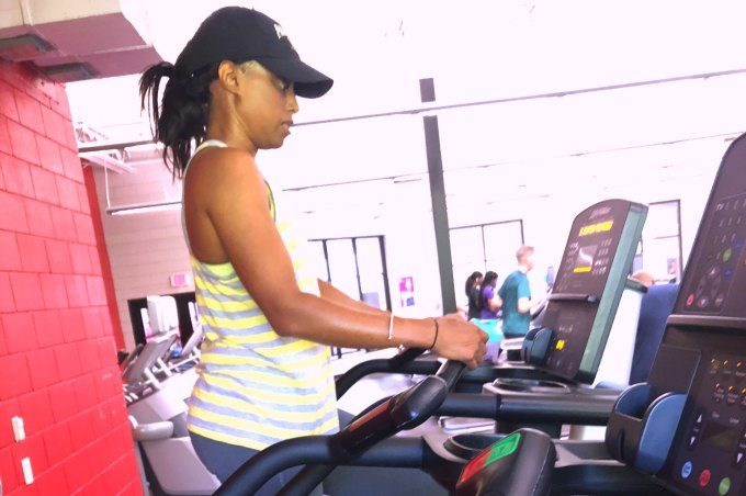 woman walking on stairmaster