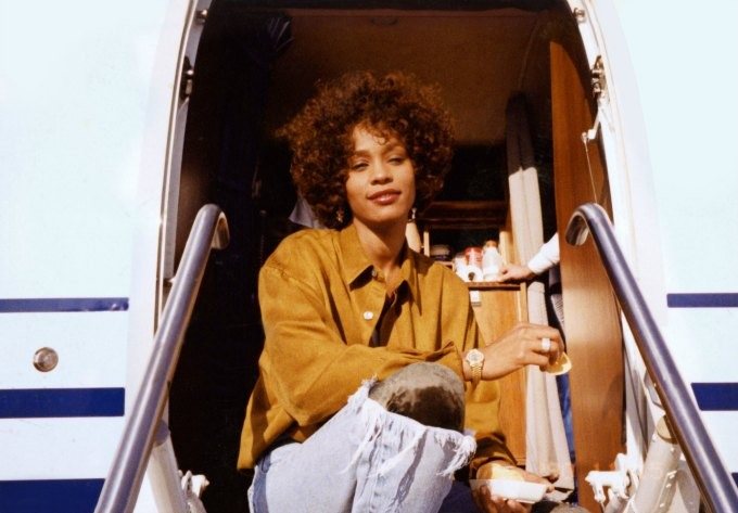 whitney houston sitting plane side