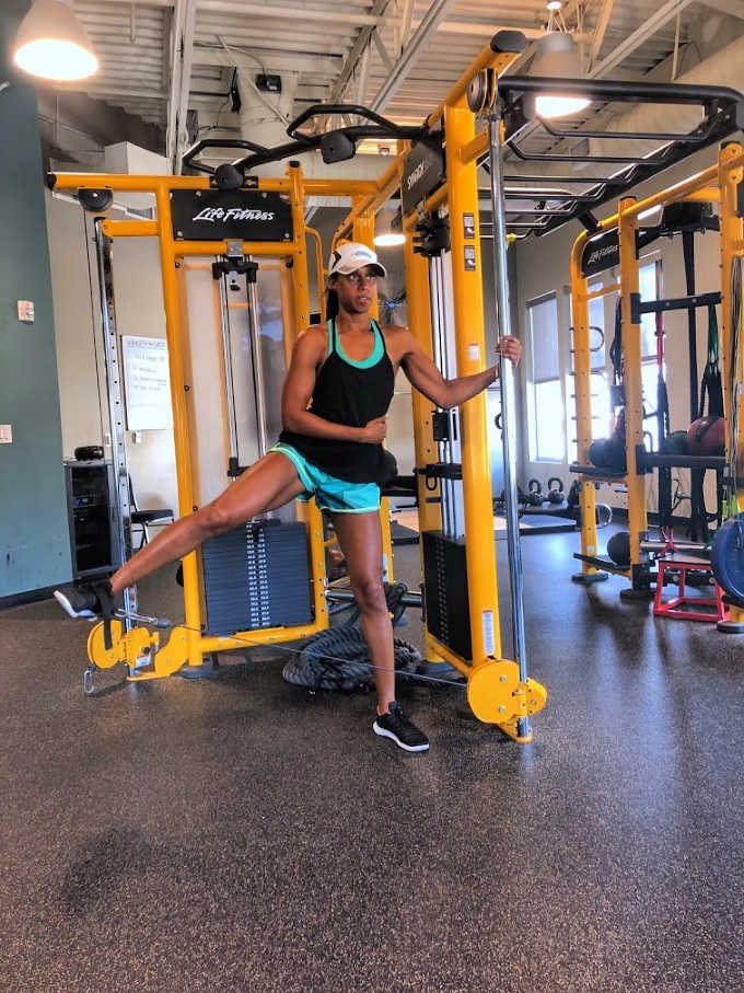 Woman using equipment in the gym