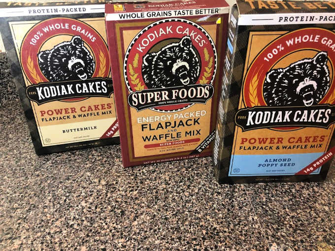 Kodiak cakes pancake mixes in buttermilk, super foods and almond poppy seed.