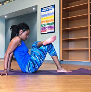 woman stretching to help with hip stiffness