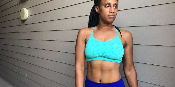 woman in green old navy sports bra