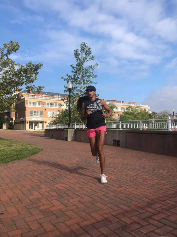 Woman running outside instead of inside on the treadmill
