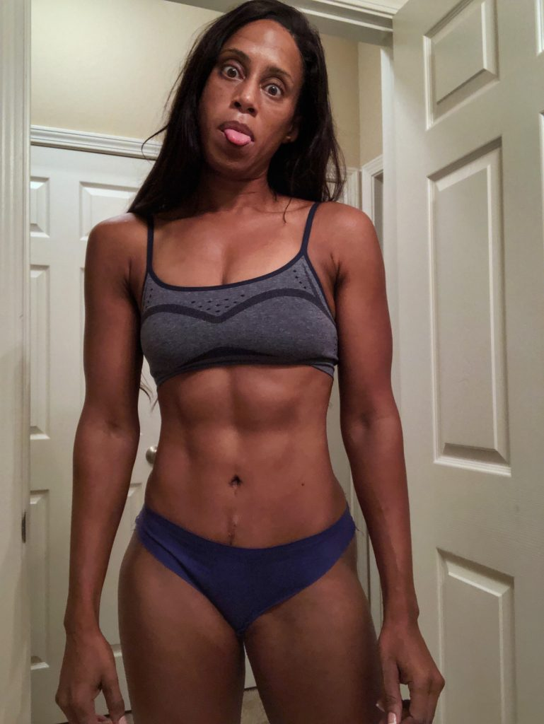 A female's defined six pack abs from doing lower abs exercises for women