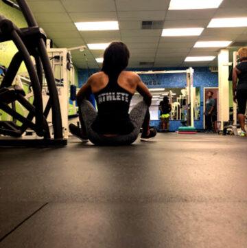 woman sitting on gym floor